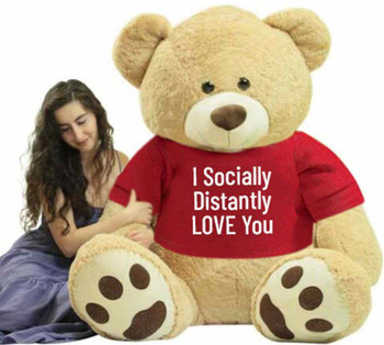 "Send this Big Plush® giant stuffed 72 inches tall teddy bear as your ambassador of love during quarantine. It gets delivered already wearing a removable t-shirt that reads: ""I Socially Distantly LOVE You""."