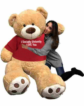 "Send this Big Plush® giant stuffed 6 foot tan teddy bear as your ambassador of love during quarantine. It gets delivered already wearing a removable t-shirt that reads: ""I Socially Distantly LOVE You""."