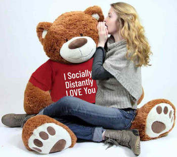 "Send this Big Plush® giant stuffed teddy bear as your ambassador of love during quarantine. It gets delivered already wearing a removable t-shirt that reads: ""I Socially Distantly LOVE You""."