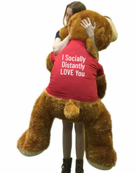 "Send this Big Plush® giant stuffed puppy dog as your ambassador of love during quarantine. It gets delivered already wearing a removable t-shirt that reads: ""I Socially Distantly LOVE You""."