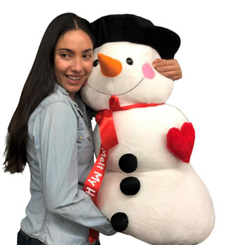 "Romantic Gift Alert 2: This big stuffed snowman wears his heart on his chest and has a ribbon that says ""You Melt My Heart"""