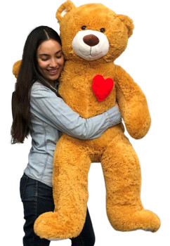 4ft brown teddy bear with heart on it's chest.