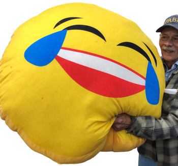 Giant Stuffed Emoji Face with Tears of Joy measures over three and a half feet wide.