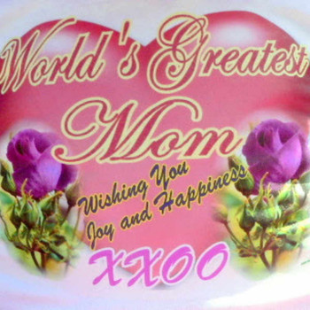 Dress your Big Plush animal in this tshirt which reads: WORLD'S GREATEST MOM - WISHING YOU JOYA ND HAPPINESS - XOXO.