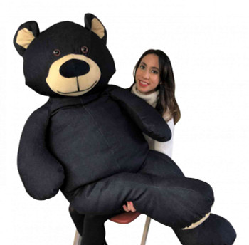 Big Plush Denim teddy bear made of real blue jeans and dungarees fabric weighs 20 pound, is 5 feet tall and is made in the USA.
