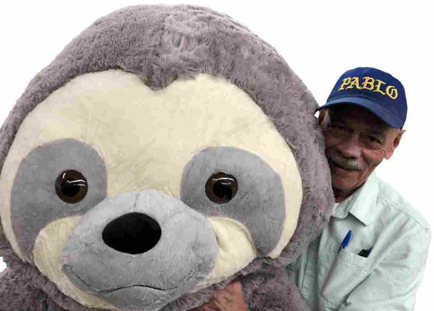 Nothing is more adorable than this smiling Big Plush 7-foot stuffed sloth.