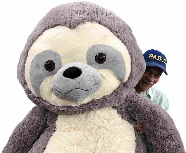 This awesome 7 feet tall plush Sloth has the most adorable and cute face.