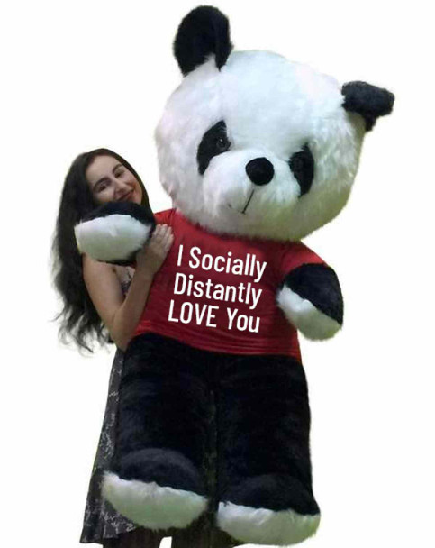 """Send this Big Plush® stuffed giant Panda bear as your ambassador of love during quarantine. It gets delivered already wearing a removable t-shirt that reads: """"I Socially Distantly LOVE You""""."""