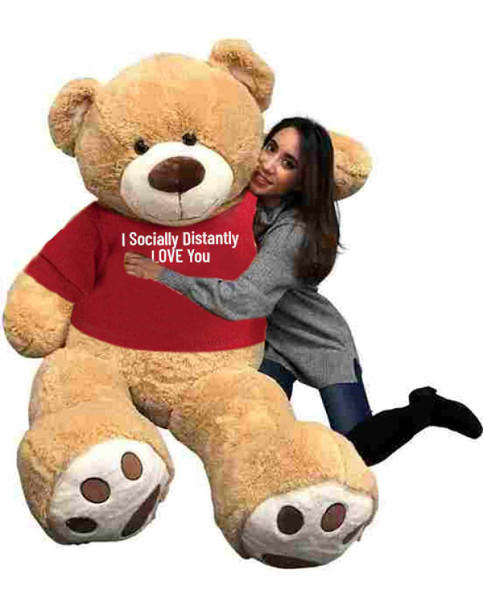 """Send this Big Plush® giant stuffed 6 foot tan teddy bear as your ambassador of love during quarantine. It gets delivered already wearing a removable t-shirt that reads: """"I Socially Distantly LOVE You""""."""