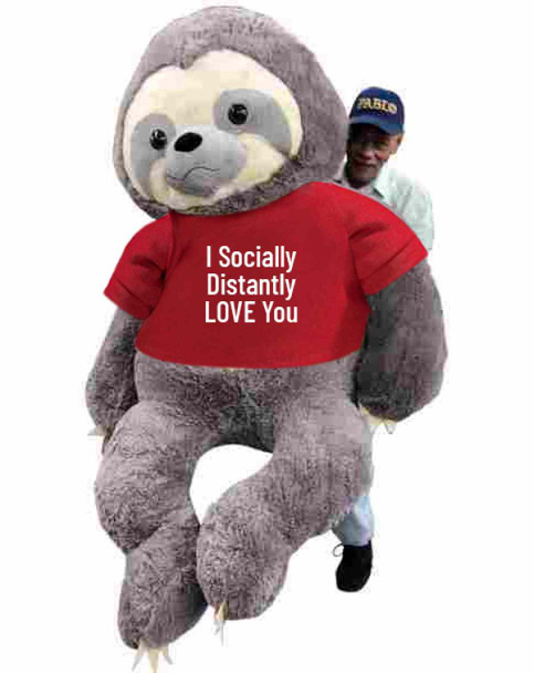 """Send this Big Plush® giant stuffed Sloth as your ambassador of love during quarantine. It gets delivered already wearing a removable t-shirt that reads: """"I Socially Distantly LOVE You""""."""