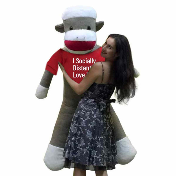 """Send this social distancing gift of love to someone special; its a giant 6 foot sock monkey that wears a removable tshirt that reads """"I Socially Distantly LOVE You""""."""