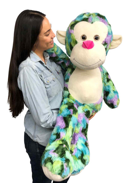 Big Stuffed Multicolor Monkey measures 40 inches tall, and is hand stuffed in the USA with pillow-soft polyester stuffing.