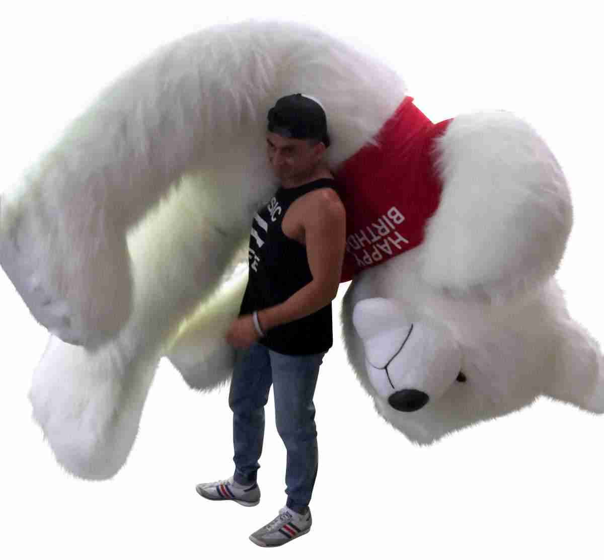 This is a photo of one of Big Plush's insanely large size giant teddy bears. It measures eight feet tall and is wearing a custom personalized t-shirt that says Happy Birthday.
