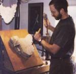 Paul Borda carving a block of wood