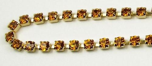 32PP (4.1mm) Topaz rhinestone chain, 48 stones per foot