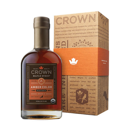 Make an uncommon impression with the distinctive Crown Maple Amber Color Rich Taste 375ML (12.7 FL OZ) organic, 100% pure maple syrup bottle in an elegant Royal Treatment box with your choice of our signature classic orange band or HAPPY HOLIDAYS band.  The aromas and flavors of gingerbread, roasted chestnut, toffee, and a hint of clove and nutmeg, are showcased in Crown Maple Amber Color Rich Taste organic, pure maple syrup which presents a medium-body feel with a depth of luxurious flavors.