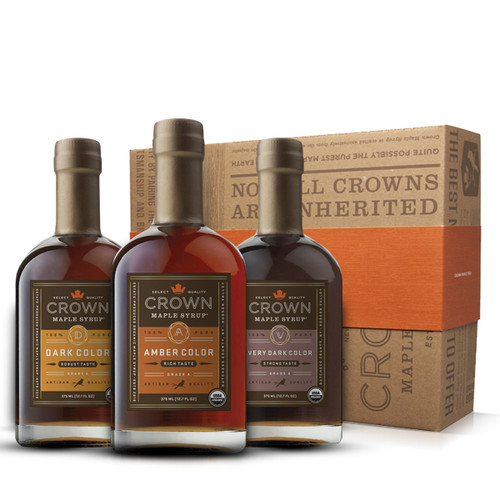 Make an uncommon impression with this distinctive Crown Maple Classic Trio Collection presented in an elegant Royal Treatment box with your choice of our signature classic orange band or HAPPY HOLIDAYS band.  Explore our classic, organic, 100% pure maple syrup sample collection featuring one 375ML (12.7 FL OZ) bottle each of Amber Color Rich Taste organic maple syrup, Dark Color Robust Taste organic maple syrup, and Very Dark Color Strong Taste organic maple syrup.  Discover the versatility of our classic, organic, 100% pure maple syrups and discover new, favorite ways to use each unique taste profile. Perhaps you'll use Amber Color Rich Taste to drizzle over a warm dessert or fresh fruit, or Dark Color Robust Taste for baking, pancakes and vinaigrettes.  Maybe you'll become hooked on Very Dark Color Strong Taste as a more flavorful and healthier sweetener for your coffee or tea, to drizzle over oatmeal or yogurt, or as a premium replacement for simple syrup in cocktails.