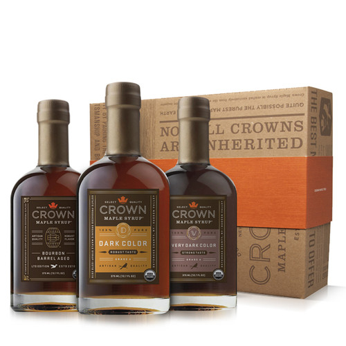 Make an uncommon impression with this distinctive Crown Maple Deluxe Trio Collection presented in an elegant Royal Treatment box with your choice of our signature classic orange band or HAPPY HOLIDAYS band.  Collection contains one 375ML (12.7 FL OZ) bottle each of Dark Color Robust Taste organic maple syrup, Very Dark Color Strong Taste organic maple syrup, and Bourbon Barrel Aged organic maple syrup (may contain up to 2% alcohol).  Discover the versatility of our estate-produced, organic maple syrups to add layers of distinctive flavors and artisan quality to elevate your favorite recipes, beverages, and more —healthier sweetener and flavor excitement for coffee & tea; topping for fruits, yogurt, oatmeal, baked goods, desserts, ice cream; marinade and basting glaze; and premium replacement for simple syrup in cocktails, and more.