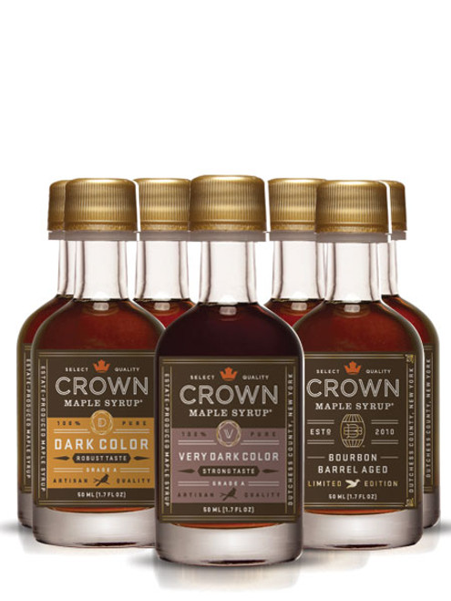 """""""Indulge in three of our most popular organic maple syrups, in easy to carry and easy to share 50ML (1.7 FL OZ) petite bottles. Collection contains four 50ML (1.7 FL OZ) petite bottles each of Dark Color Robust Taste organic maple syrup, Very Dark Color Strong Taste organic maple syrup, and Bourbon Barrel Aged organic maple syrup (may contain up to 2% alcohol)."""""""