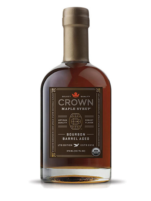 """Distinctive aromas and flavors of bourbon, smoky oak, graham cracker, brown butter & creamy vanilla are showcased in Crown Maple Bourbon Barrel Aged organic maple syrup which presents exceptional layers of luxurious flavors.  First, certified organic, pure maple syrup is aged in barrels to absorb the flavor of bourbon from the oak. Then, we bottled it at our state-of-the-art sugarhouse in Dover Plains, in New York's Hudson Valley. The elegant packaging of this unique syrup is designed to reflect the superb quality of the product within, described in The Wall Street Journal as """"soul-stirring""""."""