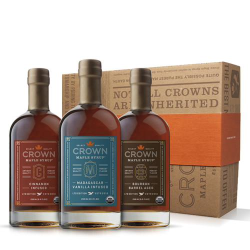Make an uncommon impression with this distinctive Crown Maple Infused Trio Collection presented in an elegant Royal Treatment box with your choice of our signature ORANGE band or HAPPY HOLIDAYS RED band.  This organic maple syrup sample collection explodes with flavor excitement allowing you to explore the versatility of our infused maple syrups. Collection contains one 250ML (8.5 FL OZ) bottle each of Bourbon Barrel Aged organic maple syrup (may contain up to 2% alcohol), Madagascar Vanilla Infused organic maple syrup, and Cinnamon Infused organic maple syrup.  Discover the versatility of our infused, organic maple syrups to add layers of distinctive flavors and artisan quality to elevate your favorite recipes, beverages, and more —healthier sweetener and flavor excitement for coffee & tea; topping for fruits, yogurt, oatmeal, baked goods, desserts, ice cream; marinade and basting glaze; and premium replacement for simple syrup in cocktails, and more.