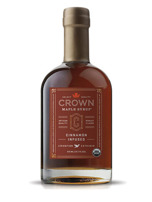 Estate-produced at our organic family farm in NY's Hudson Valley, Crown Maple Cinnamon Infused organic maple syrup features a real organic cinnamon stick infused in our select quality maple syrup. The sweet and spicy floral notes of cinnamon accentuate the brown butter and toasted pecan notes to create an exceptional maple syrup that is warm and comforting.  You will find yourself adding this to everything from yogurt to oatmeal, as a sweetener for coffee, as a versatile ingredient for holiday baking and flavoring for squash and vegetables, in a vinaigrette, in place of simple syrup for cocktail mixology, and, of course, to create an exceptional breakfast of pancakes, waffles, and French toast!  Contains real, organic cinnamon stick.  • All Natural Sweetener & Flavor for Coffee & Tea • Top Oatmeal, Yogurt & Cereals • Warm Flavor Comfort for Breakfast Foods • Adds Depth of Flavor to Cheese, Sauces & Vinaigrettes • Flavor Excitement for Baking & Pastry Recipes • Dessert Glazes & Toppings