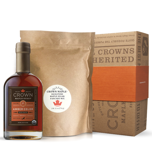 Gather around the breakfast table and indulge with estate-produced, organic Crown Maple syrup and our signature pancakes. Fresh from the Crown Maple Estate, our artisan quality recipe delivers a distinctive pancake experience featuring Crown Maple sugar and Crown Maple sugar pearls that explode with maple flavor on the griddle.  The Pancake Breakfast pack includes one Crown Maple Pancake Mix 28 Oz. (794g) and your choice of Crown Maple syrup 375 ML (12.7 FL OZ)—Amber Color Rich Taste, Dark Color Robust Taste, or 250 ML (8.5 FL OZ) flavor infused artisan syrup—Bourbon Barrel Aged, Madagascar Vanilla Infused, Cinnamon Infused organic maple syrup.  Ships in our distinctive Royal Treatment box with your choice of our signature ORANGE band or HAPPY HOLIDAYS RED band.  Contains:  Wheat  This product is produced and packed in a facility and on equipment that processes milk, egg, fish, crustacean shellfish, tree nuts, wheat, peanuts, and soy.