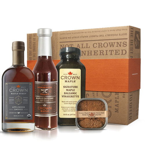 Gather around the grill and fire up pure flavor excitement as you indulge with a collection of Crown Maple products. This signature collection showcases estate-produced Crown Maple products carefully crafted for entertaining around the grill—from meats and seafood, to appetizers, salads, side dishes, cocktails, and more.  This Crown Maple Grill Pack includes Crown Maple Applewood Smoked Maple Syrup 250 ML (8.5 Fl. Oz.), Crown Maple Original Spiced Rub 170 G (6.0 Oz.), Crown Maple Signature Vinaigrette 16 Oz., and Maple Cayenne Hot Sauce 273 ML (8.0 Fl. Oz.) from Horseshoe Brand and Crown Maple.  Ships in our distinctive Royal Treatment box with your choice of our signature ORANGE band or HAPPY HOLIDAYS RED band.    Some of these products are produced and packed in a facility and on equipment that processes milk, egg, fish, crustacean shellfish, tree nuts, wheat, peanuts, and soy.