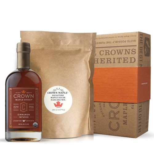 Gather around the breakfast table and indulge with estate-produced, organic Crown Maple syrup and our signature pancakes. Fresh from the Crown Maple Estate, our artisan quality recipe delivers a distinctive pancake experience featuring Crown Maple sugar and Crown Maple sugar pearls that explode with maple flavor on the griddle.  The Pancake Breakfast pack includes one Crown Maple Pancake Mix 28 Oz. (794g) and Crown Maple Cinnamon Infused organic maple syrup 250 ML (8.5 FL OZ) and ships in our distinctive Royal Treatment box with your choice of our signature ORANGE band or HAPPY HOLIDAYS RED band.  CINNAMON INFUSED Estate-produced at our organic family farm in NY's Hudson Valley, Crown Maple Cinnamon Infused organic maple syrup features a real organic cinnamon stick infused in our select quality maple syrup. The sweet and spicy floral notes of cinnamon accentuate the brown butter and toasted pecan notes to create an exceptional maple syrup that is warm and comforting.  You will find yourself adding this to everything from yogurt to oatmeal, as a sweetener for coffee, as a versatile ingredient for holiday baking and flavoring for squash and vegetables, in a vinaigrette, in place of simple syrup for cocktail mixology, and, of course, to create an exceptional breakfast of pancakes, waffles, and French toast!  Contains real, organic cinnamon stick.  • All Natural Sweetener & Flavor for Coffee & Tea • Top Oatmeal, Yogurt & Cereals • Warm Flavor Comfort for Breakfast Foods • Adds Depth of Flavor to Cheese, Sauces & Vinaigrettes • Flavor Excitement for Baking & Pastry Recipes • Dessert Glazes & Toppings  Contains: Wheat  This product is produced and packed in a facility and on equipment that processes milk, egg, fish, crustacean shellfish, tree nuts, wheat, peanuts, and soy.