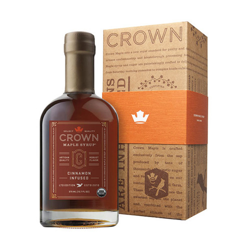 Make an uncommon impression with the distinctive Crown Maple Cinnamon Infused 375ML (12.7 FL OZ) organic maple syrup bottle in an elegant Royal Treatment box with your choice of our signature ORANGE band or HAPPY HOLIDAYS RED band.   Estate-produced at our organic family farm in NY's Hudson Valley, Crown Maple Cinnamon Infused organic maple syrup features a real organic cinnamon stick infused in our select quality maple syrup. The sweet and spicy floral notes of cinnamon accentuate the brown butter and toasted pecan notes to create an exceptional maple syrup that is warm and comforting.  You will find yourself adding this to everything from yogurt to oatmeal, as a sweetener for coffee, as a versatile ingredient for holiday baking and flavoring for squash and vegetables, in a vinaigrette, in place of simple syrup for cocktail mixology, and, of course, to create an exceptional breakfast of pancakes, waffles, and French toast!  Contains real, organic cinnamon stick.  • All Natural Sweetener & Flavor for Coffee & Tea • Top Oatmeal, Yogurt & Cereals • Warm Flavor Comfort for Breakfast Foods • Adds Depth of Flavor to Cheese, Sauces & Vinaigrettes • Flavor Excitement for Baking & Pastry Recipes • Dessert Glazes & Toppings