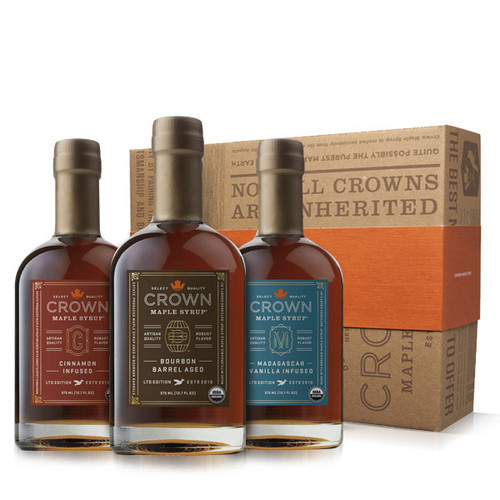 Make an uncommon impression with this distinctive Crown Maple Infused Trio Collection presented in an elegant Royal Treatment box with your choice of our signature ORANGE band or HAPPY HOLIDAYS RED band.  This organic maple syrup sample collection explodes with flavor excitement allowing you to explore the versatility of our infused maple syrups. Collection contains one 375ML (12.7 FL OZ) bottle each of Bourbon Barrel Aged organic maple syrup (may contain trace amounts of alcohol), Madagascar Vanilla Infused organic maple syrup, and Cinnamon Infused organic maple syrup.  Discover the versatility of our infused, organic maple syrups to add layers of distinctive flavors and artisan quality to elevate your favorite recipes, beverages, and more —healthier sweetener and flavor excitement for coffee & tea; topping for fruits, yogurt, oatmeal, baked goods, desserts, ice cream; marinade and basting glaze; and premium replacement for simple syrup in cocktails, and more.