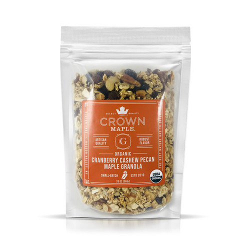 Fresh baked in small-batches, the Crown Maple Cranberry Cashew Pecan Maple Granola is packed with flavor, crunch and excitement.  This granola is made with maple syrup to give the toasted oats a perfect balance of sweetness. Made with gluten-free whole rolled oats, a whole-grain superfood that is low in calories, and high in protein, fiber, and vitamins.  What really distinguishes this granola is the addition of buttery pecans and cashews balanced by the tangy, sweet taste of juice-infused dried cranberries. Our granola is also naturally plant-based, with all the good coconut fats working for you.  This granola is packed full of crunchy goodness that makes a hearty snack by itself, pairs perfectly with Greek yogurt, as a sprinkle on fruit, or as a secret ingredient in a salad.  Made with 100% Pure Maple. The Best Nature has to Offer TM.  Contains: Cashew, Coconut, Pecan  Processed in a facility that handles tree nuts and soy. Peanut-free facility.
