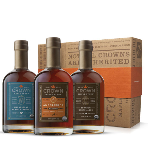 Make an exceptional impression with this distinctive Crown Maple Premium Trio Collection presented in an elegant Royal Treatment box with your choice of our signature ORANGE band or HAPPY HOLIDAYS RED band.  This Premium Collection features three of our most popular estate-produced maple syrups allowing you to explore the versatility of maple syrup. Collection contains one 375ML (12.7 FL OZ) bottle each of Amber Color Rich Taste organic maple syrup, Bourbon Barrel Aged organic maple syrup (may contain trace amounts of alcohol), and Madagascar Vanilla Infused organic maple syrup.  Discover the versatility of organic maple syrup to add layers of distinctive flavors and artisan quality to elevate your favorite recipes, beverages, and more —healthier sweetener and flavor excitement for coffee & tea; topping for fruits, yogurt, oatmeal, baked goods, desserts, ice cream; marinade and basting glaze; and premium replacement for simple syrup in cocktails, and more.