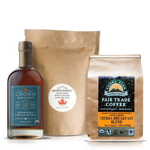 This Breakfast Care Package is an elegant way to slow down and spend some quality time around the table enjoying a warming and comforting breakfast. Share this moment of joy with friends and family to let them know you are thinking of them.     The Breakfast Care Package includes:  Crown Maple® Madagascar Vanilla Infused Organic Maple Syrup 250ML (8.5 FL OZ) features the aromatic and tantalizing floral aromas of Madagascar vanilla which complements the graham cracker and brown butter notes of our Dark Color maple syrup to present a delicate and creamy body with buttery sweet notes that builds intrigue. Pairs perfectly with pancakes and as an elegant sweetener in coffee.  Crown Maple Signature Maple Sugar Pancake Mix 28 Oz. (794g), an artisan quality recipe that delivers a distinctive pancake experience featuring Crown Maple sugar and Crown Maple sugar pearls that explode with maple flavor on the griddle. Contains: Wheat  Tierra Farms Organic Tierra Breakfast Blend Coffee, Whole Bean, 12 oz. featuring a specially selected blend of Central American and Indonesian beans, handpicked by the globetrotting Tierra Farms coffee buying team. The bold, smooth coffee has light acidity and a medium body. Look for the taste of almonds and chocolate. When this coffee hits your lips, you will be ready to greet the sunshine and indulge in your stack of pancakes.        Note: Pancake Mix produced and packed in a facility and on equipment that processes milk, egg, fish, crustacean shellfish, tree nuts, wheat, peanuts, and soy.