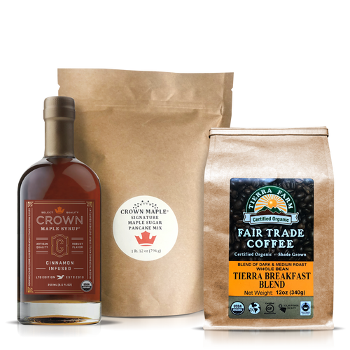 This Breakfast Care Package is an elegant way to slow down and spend some quality time around the table enjoying a warming and comforting breakfast. Share this moment of joy with friends and family to let them know you are thinking of them.     The Breakfast Care Package includes:  Crown Maple® Breakfast Care Package with Crown Maple® Cinnamon Infused Organic Maple Syrup 250ML (8.5 FL OZ) features the sweet and spicy floral notes of cinnamon that accentuate the brown butter and toasted pecan notes of our Dark Color maple syrup to create a warm and comforting flavor. presented. This syrup accentuates and elevates your stack of pancakes and creates a soothing mug of coffee.  Crown Maple Signature Maple Sugar Pancake Mix 28 Oz. (794g), an artisan quality recipe that delivers a distinctive pancake experience featuring Crown Maple sugar and Crown Maple sugar pearls that explode with maple flavor on the griddle. Contains: Wheat  Tierra Farms Organic Tierra Breakfast Blend Coffee, Whole Bean, 12 oz. featuring a specially selected blend of Central American and Indonesian beans, handpicked by the globetrotting Tierra Farms coffee buying team. The bold, smooth coffee has light acidity and a medium body. Look for the taste of almonds and chocolate. When this coffee hits your lips, you will be ready to greet the sunshine and indulge in your stack of pancakes.        Note: Pancake Mix produced and packed in a facility and on equipment that processes milk, egg, fish, crustacean shellfish, tree nuts, wheat, peanuts, and soy.