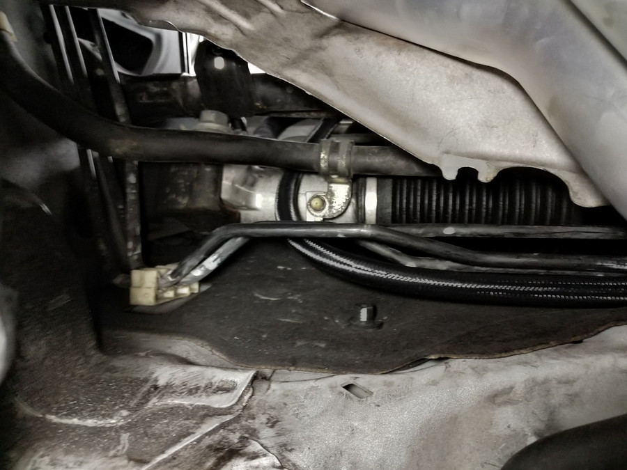 Feed Line Routed against the Fire Wall Behind the OEM Heat Shield