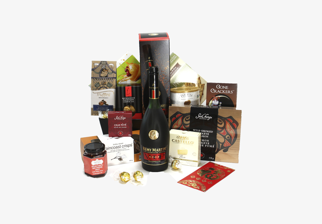 Gourmet gift basket featuring Remy Martin champagne cognac and snacks (crackers, cheese, pate
