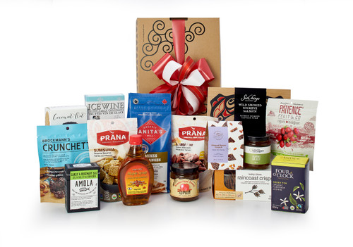 Gourmet gift basket featuring Canadian local snacks (chocolate, crackers, smoked salmon, maple syrup, etc.), packaged in signature Green & Green gift box with ribbon and bow.