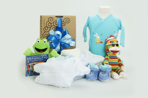 Gift basket for new baby, featuring blue blanket, blue clothing, rainbow sock monkey, and toys, packaged in our signature Green & Green gift box with blue ribbon and bow.