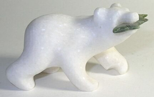 Statue of a white marble bear carrying a jade salmon.