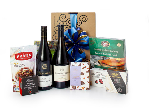 Gourmet gift basket featuring Gray Monk Pinot Noir, Tinhorn Creek Pinot Gris 2018 , and BC local savoury snacks (crackers, cheese, smoked salmon, etc.) packaged in signature Green & Green gift box with ribbon and bow.