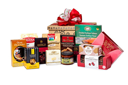Gourmet gift basket featuring sweet and savoury snacks (chocolate, cookies, crackers, nuts, etc.) packaged in signature Green & Green gift box with red ribbon and bow.