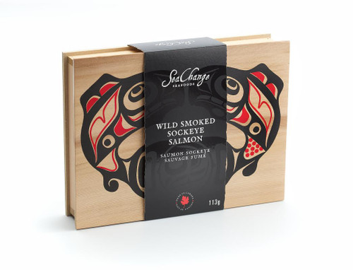 Cedar box of smoked salmon, featuring West Coast First Nations' salmon design in red and black.