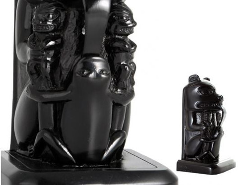Black recycled glass bookend featuring West Coast First Nations bear design.