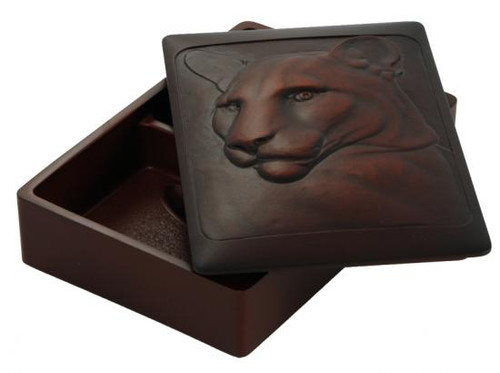 Recycled glass box carved with cougar design.