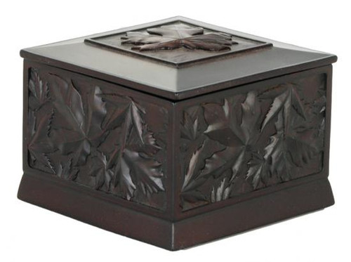 Black recycled glass box carved with maple leaf design.