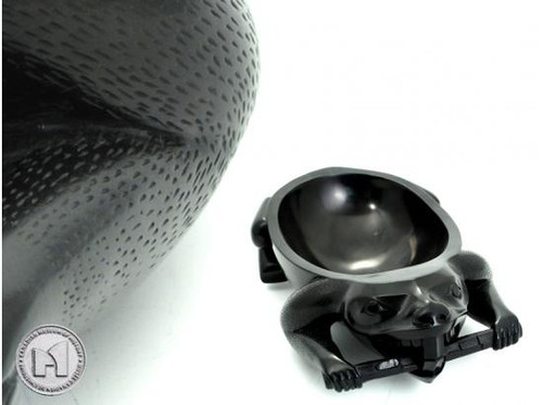 Black recycled glass bowl carved in West Coast First Nations beaver design.