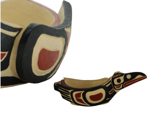 Potlatch bowl carved in West Coast First Nations raven design, with red, black, and cream colours.