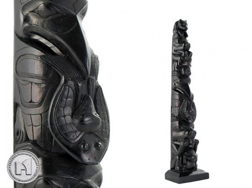 Black recycled glass totem pole featuring West Coast First Nations' bear mother design.