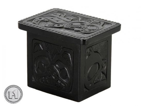 Black marble box with West Coast First Nations' sea monster design.